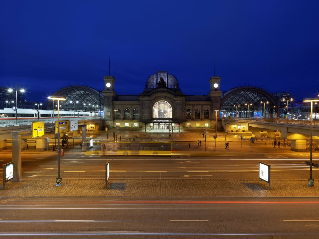 Stock Photo: 1801-76272 Dresden Hauptbahnhof, Dresden, Germany. Architect: Foster + Partners, 2006. Distant view of Dresden Hauptbahnhof at night.
