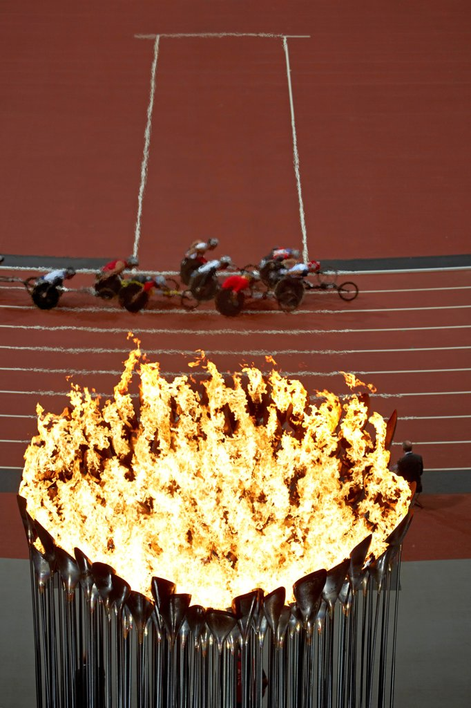 Stock Photo: 1801-76829 Olympic Cauldron, Art Installation, Europe, United Kingdom, , 2012, Heatherwick Studio. Abstract view from above showing cauldron with Paralympic athletes.
