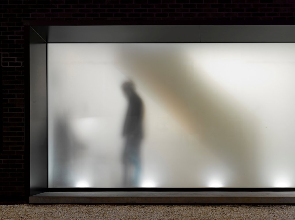The Long House, Home Extension, Europe, United Kingdom, Hampshire, 2012, Dan Brill Architects. Detail of frosted glass with figure. : Stock Photo