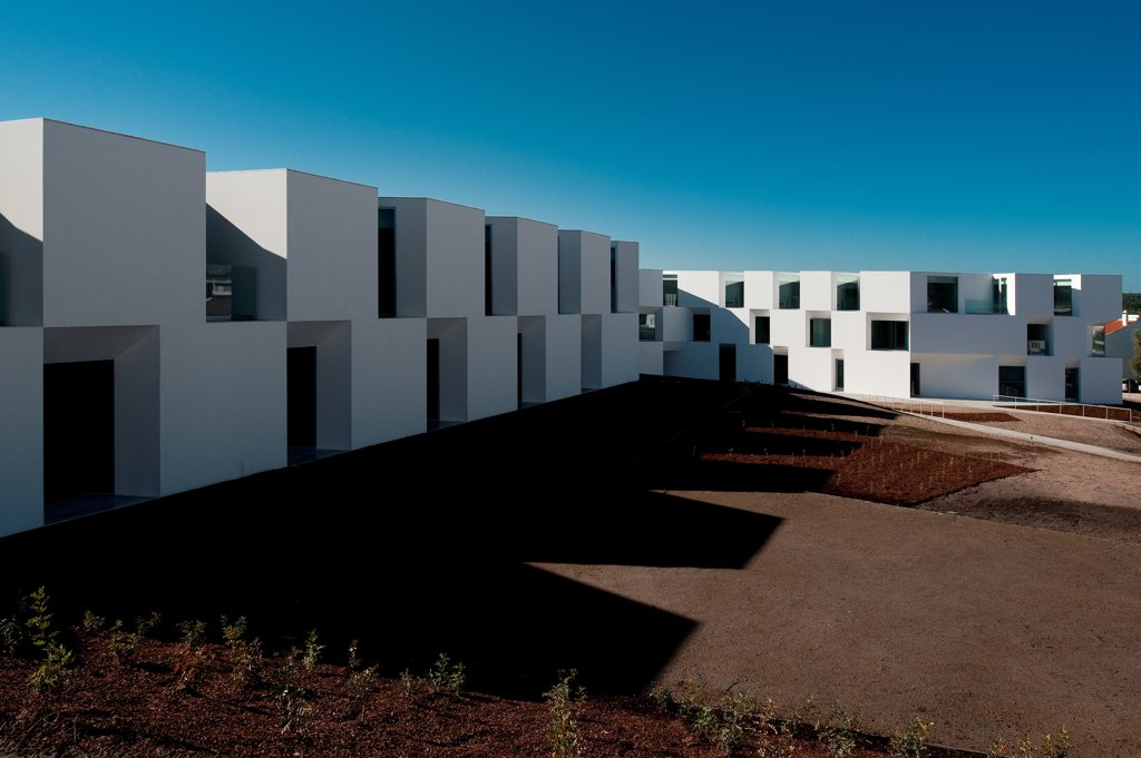 Stock Photo: 1801-77024 House for Elderly People, Alcaçer do Sal, Portugal. Architect: Francisco Aires Mateus Arquitectos, 2011. View of social housing complex in daylight.