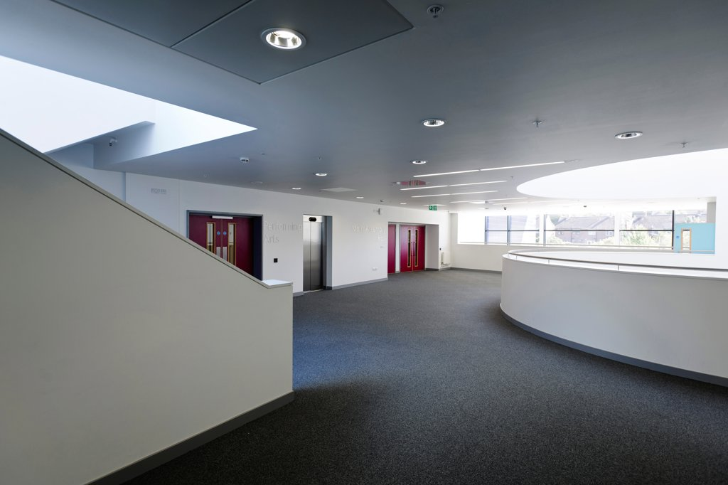 Stock Photo: 1801-77121 Strood Academy, Academy School, Europe, United Kingdom, Kent, 2012, Nicholas Hare Architects LLP. Interior showing semi-circular void circulation space and stairway.