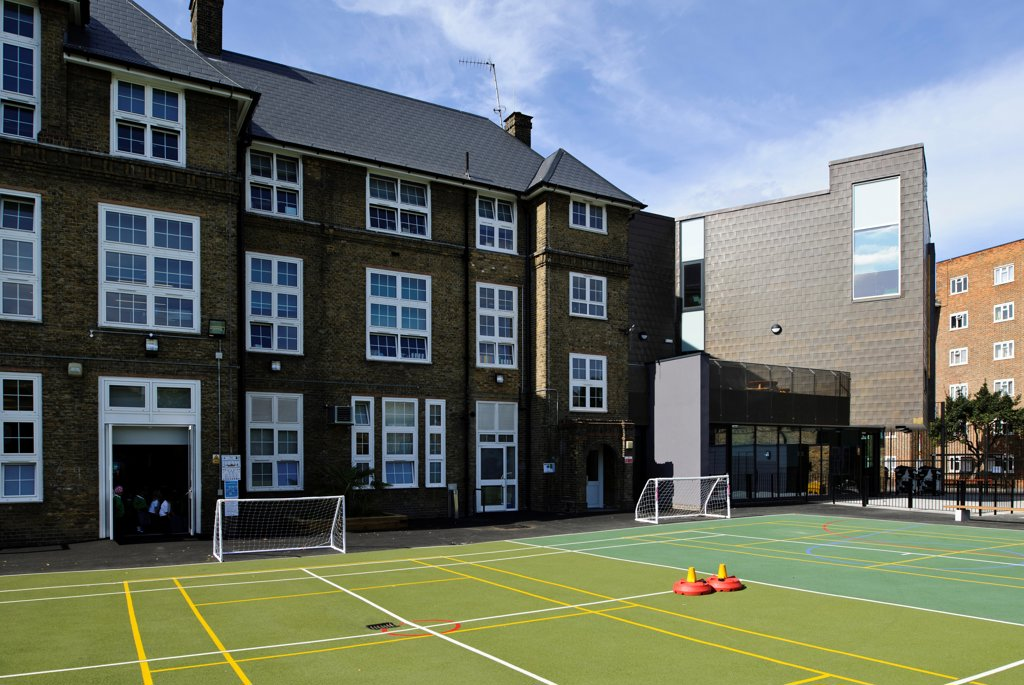Stock Photo: 1801-77237 Orchard Primary School, Primary School, Europe, United Kingdom, , 2012, Rivington Street Studio. View of empty playground, reception entrance, new extension and existing buildings.