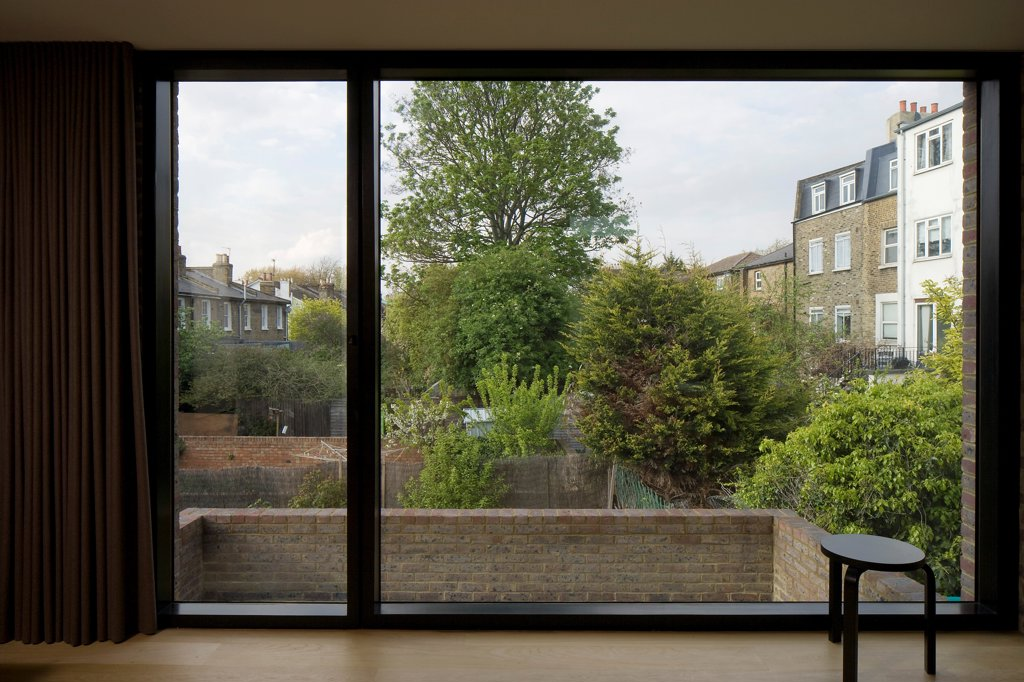 Stock Photo: 1801-77270 KINGS'S GROVE, London, United Kingdom. Architect: Duggan Morris Architects Ltd, 2010. Upstairs office with view over gardens.