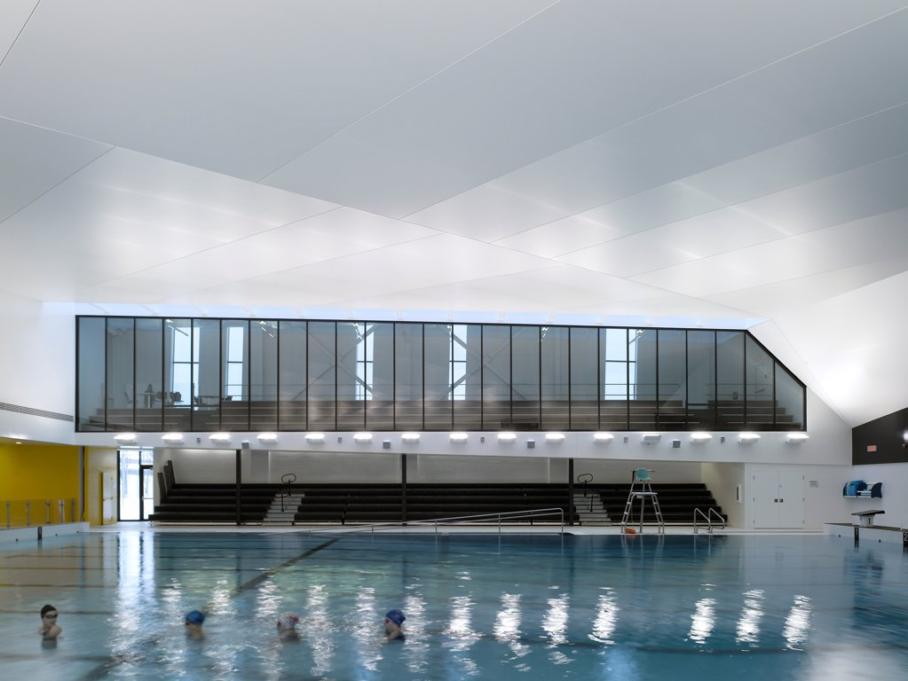 Centre Aquatique, St Hyacinthe, St Hyacinthe, Canada. Architect: Architecture, 2012. View of pool showing viewing gallery. : Stock Photo