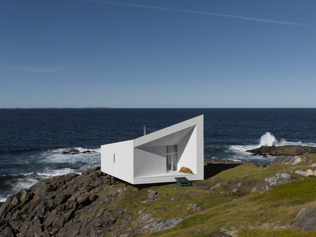 Stock Photo: 1801-77311 Squish Studio, Fogo Island, Canada. Architect: Todd Saunders, 2011. View of studio from hill, daytime.