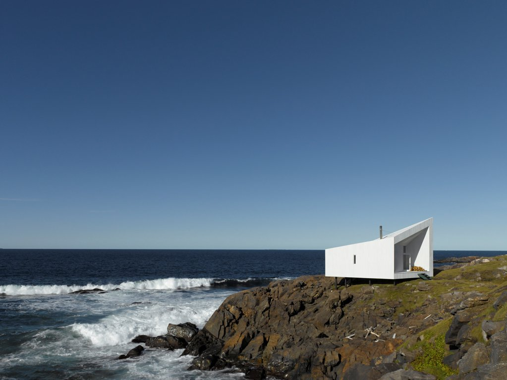 Squish Studio, Fogo Island, Canada. Architect: Todd Saunders, 2011. Far away view of studio daytime. : Stock Photo