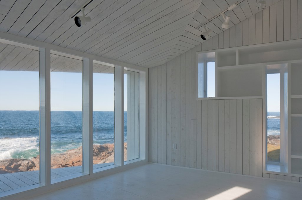 Stock Photo: 1801-77318 Squish Studio, Fogo Island, Canada. Architect: Todd Saunders, 2011. View onto ocean from inside.