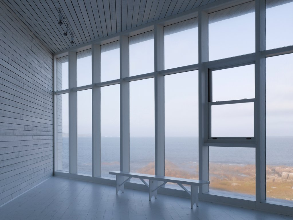 Long Studio, Fogo Island, Canada. Architect: Todd Saunders, 2011. Interior view out over ocean. : Stock Photo
