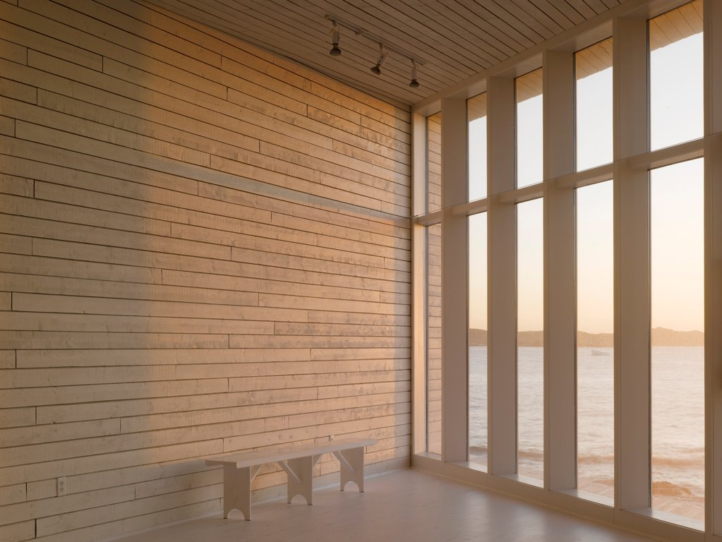 Stock Photo: 1801-77325 Long Studio, Fogo Island, Canada. Architect: Todd Saunders, 2011. Interior view out over ocean.