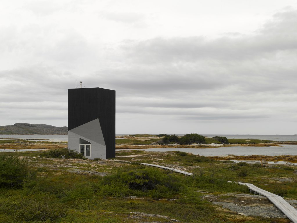 Tower Studio, Fogo Island, Canada. Architect: Todd Saunders, 2011. View across marsh, with ribbon walkway. : Stock Photo