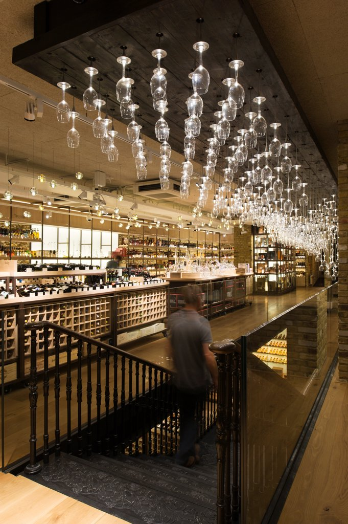 Hedonism Wines, Showroom, Europe, United Kingdom, , 2012, Universal Design Studio, Speirs + Major. Ground Floor view with chandelier. : Stock Photo
