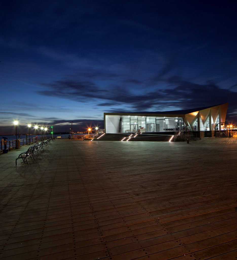 Stock Photo: 1801-77438 Southend Pier Cultural Centre, Southend, United Kingdom. Architect: White Architects, 2012. Dusk shot of the main front elevation.