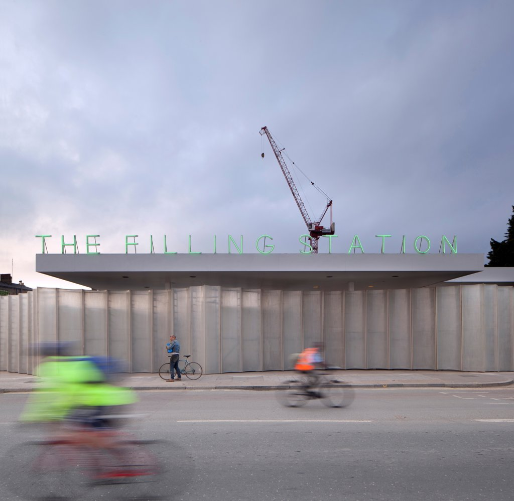 The Filling Station, London, United Kingdom. Architect: Carmody Groarke, 2012. Front view with cyclists. : Stock Photo