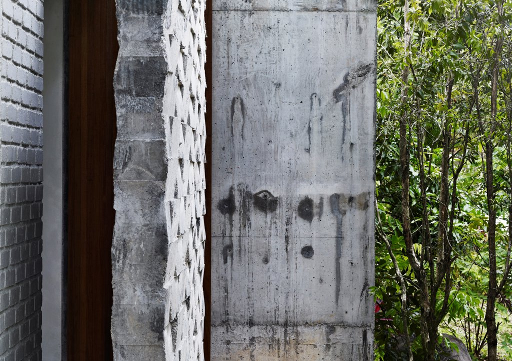 Stock Photo: 1801-77643 Dog Concrete House, Kuala Lumpur, Malaysia. Architect: Kevin Low, 2012. Pattern concrete facade detail.