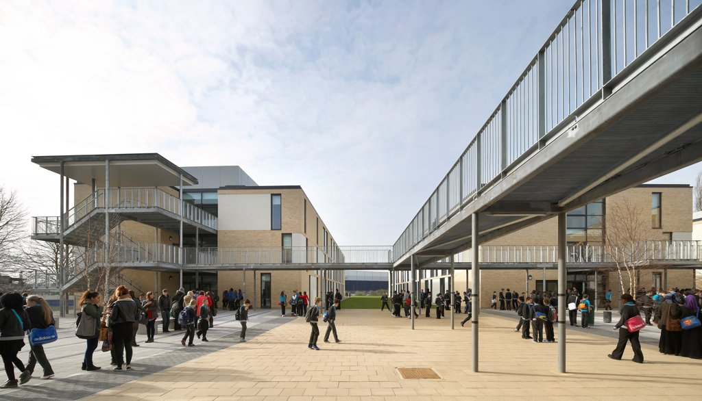 Stock Photo: 1801-78851 Thomas Tallis School, Greenwich, United Kingdom. Architect: John Mcaslan & Partners, 2012. Concourse Elevation With Building Links And Bridge.