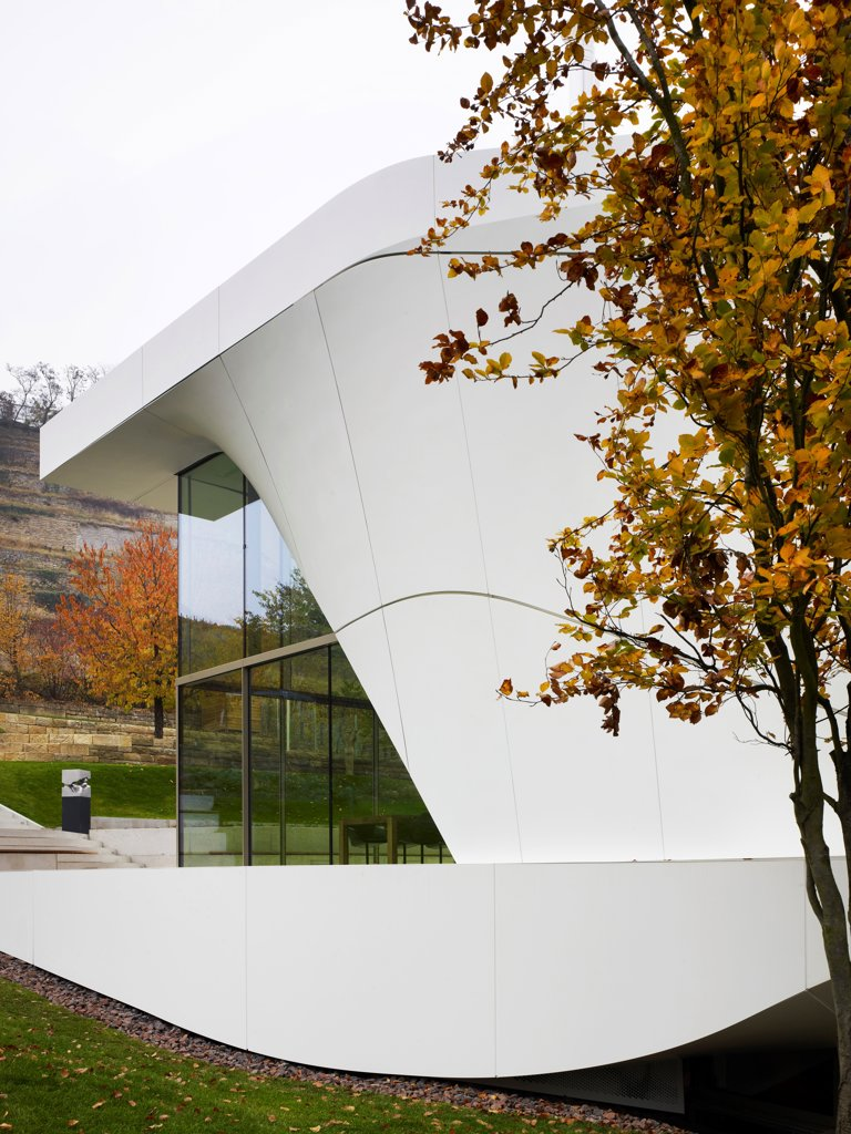 Stock Photo: 1801-79896 Haus Am Weinberg, Stuttgart, Germany. Architect: Un Studio, 2011. Detail Of Curved, All White Concrete Structure With Corner Glazing.