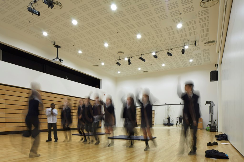 Stanley Park High School, Sutton, United Kingdom. Architect: Haverstock Associates Llp, 2012. Multifunctional Sport- And Performance Space With Students In Motion. : Stock Photo