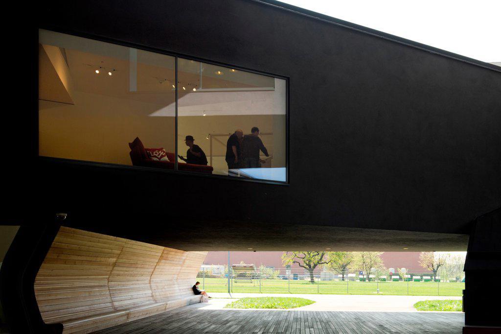 Stock Photo: 1801-81134 Vitra Haus, Weil Am Rhein, Germany. Architect: Herzog De Meuron, 2010. Vista Of Exhibition Space Above And Underpass Below.