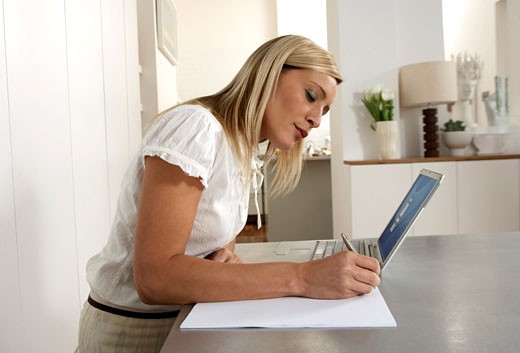 Young woman working from home  : Stock Photo