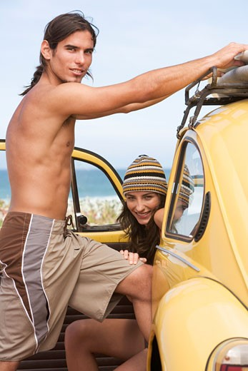Stock Photo: 1804R-10394 A young couple on a beach