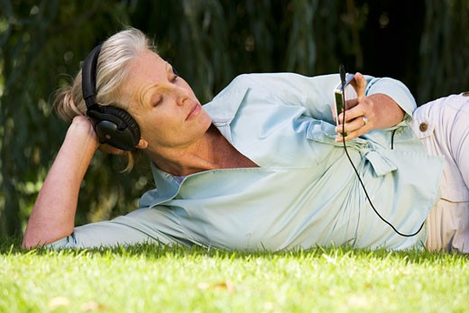 Stock Photo: 1804R-10465 A senior woman listening to music