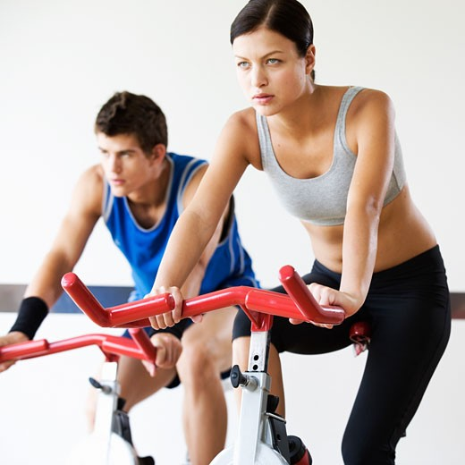 Two young people exercising : Stock Photo