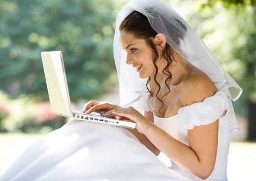 Stock Photo: 1804R-10666 A bride using a laptop