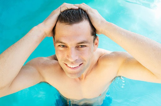 A man swimming in a pool : Stock Photo
