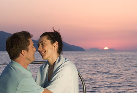 A couple kissing on a boat : Stock Photo