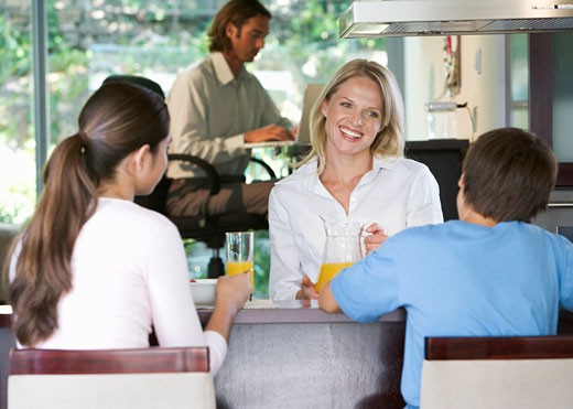 A family eating breakfast : Stock Photo