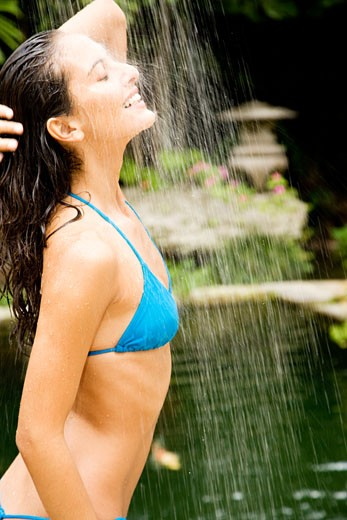 Stock Photo: 1804R-12173 Beauty portrait of a woman in a tropical shower setting.