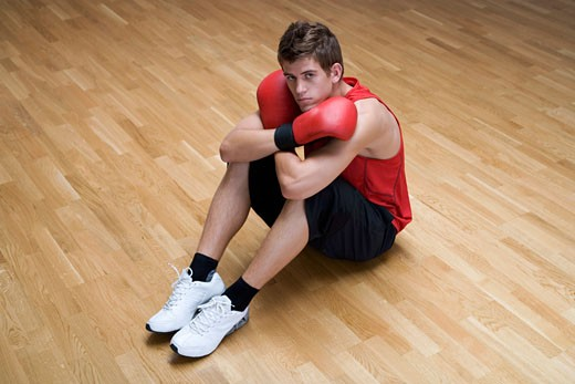 Stock Photo: 1804R-12928 A young man wearing boxing gloves