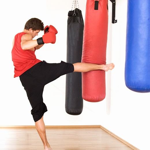 A young man kick boxing : Stock Photo