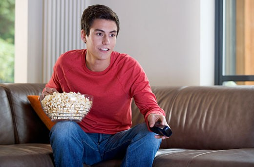 Stock Photo: 1804R-13238 A teenage boy watching television