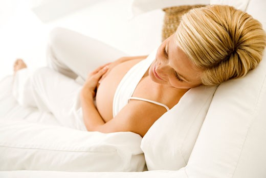 A pregnant woman relaxing : Stock Photo