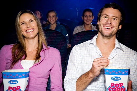Stock Photo: 1804R-1394 Couple enjoying a film at the cinema
