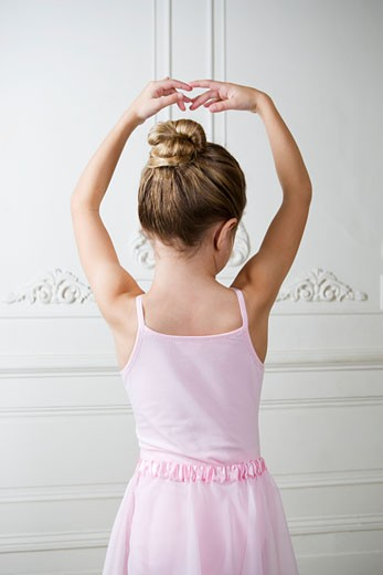 Young girl performing a ballet move  : Stock Photo