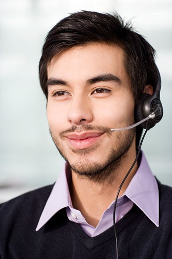 Stock Photo: 1804R-15511 A man wearing a headset