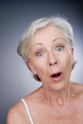 A senior woman looking surprised : Stock Photo