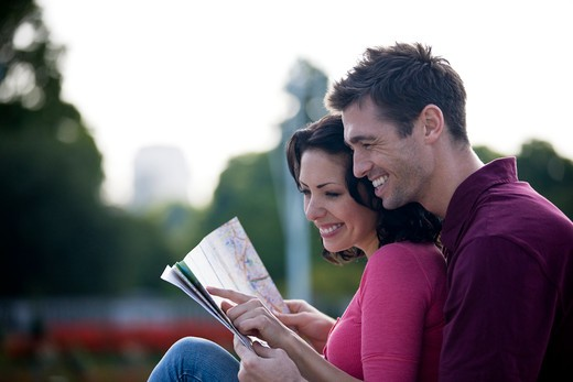 A young couple looking at a map of London : Stock Photo