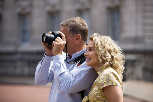 Stock Photo: 1804R-20438 A middle-aged couple taking a photograph