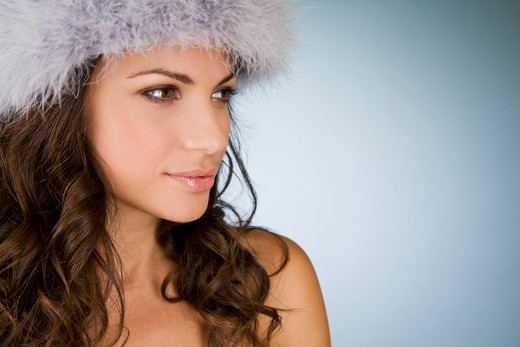 Stock Photo: 1804R-20755 A young woman wearing a winter hat
