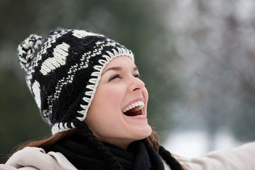 A young woman wearing a woolen hat, enjoying the open air : Stock Photo