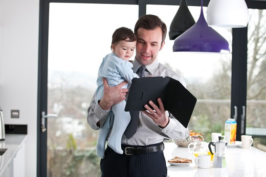 Stock Photo: 1804R-20991 A father and baby son looking at a digital tablet