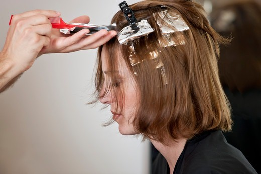 Stock Photo: 1804R-21154 A female client having her hair coloured in a hairdressing salon, close up