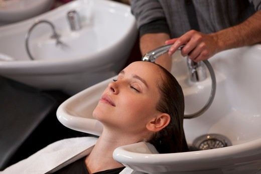 A female client having her hair washed in a hairdressing salon, close up : Stock Photo