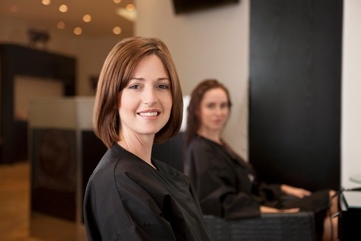 Stock Photo: 1804R-21176 A female client showing off her new haircut