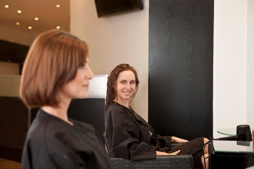 Stock Photo: 1804R-21177 Two female clients sitting in a hairdressing salon