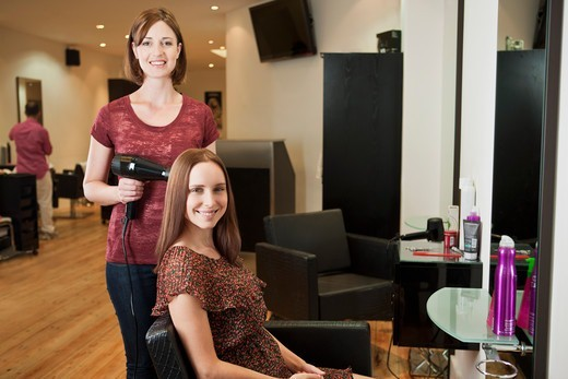 Stock Photo: 1804R-21200 A female hairdresser and female client in a hairdressing salon