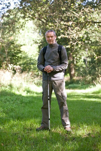Stock Photo: 1804R-21230 A portrait of a mature man standing in the countryside